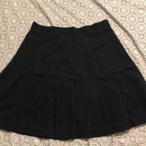 Pleated black skirt.